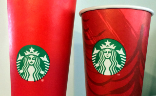 This November 9, 2015 photo shows the 2014(R) and 2015 Starbucks holiday cups in Washington, DC. The unadorned 2015 red cup which debuted November 1 came under fire for its lack of design. Creating a culture of belonging, inclusion and diversity is one of the core values of Starbucks, and each year during the holidays the company aims to bring customers an experience that inspires the spirit of the season, the company wrote in a press release. Starbucks will continue to embrace and welcome customers from all backgrounds and religions in our stores around the world.AFP PHOTO/ KAREN BLEIER (Photo credit should read KAREN BLEIER/AFP/Getty Images)