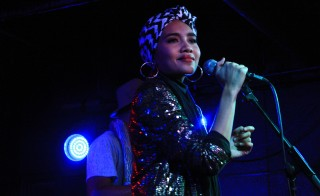 """People were not used to to the idea of me being a Muslim singer,"" says singer and songwriter Yuna of her introduction to the  U.S. music scene. ""They'd be like 'Oh, wow, you are a Muslim singer, can you do that?' like I'm a nun or something."" Yuna spoke with NewsHour after performing at U Street Music Hall in Washington last month. Photo by Amanda Gomez"
