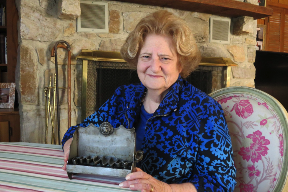 Jeanette Eichenwald holds a family heirloom menorah that survived the Holocaust.