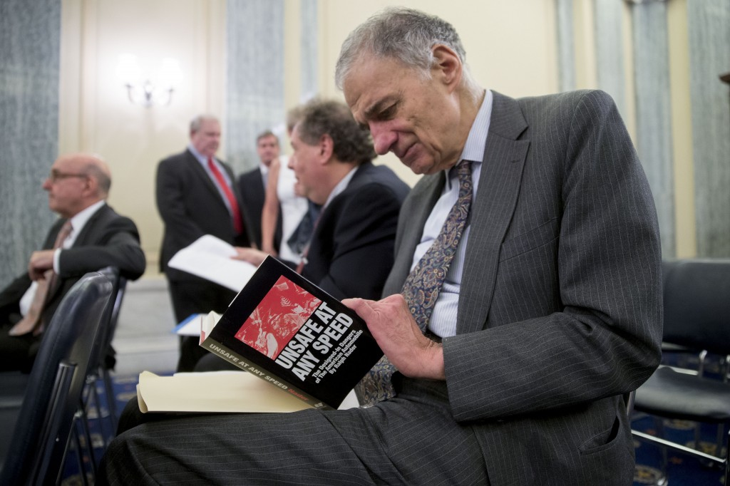 "Nader, the founder of Public Citizen Inc., holds a copy of his book ""Unsafe at any Speed"" before a Senate Consumer Protection, Product Safety, and Insurance Subcommittee hearing in Washington, D.C., U.S., on July 17, 2014. Photo by Andrew Harrer/Bloomberg via Getty Images."