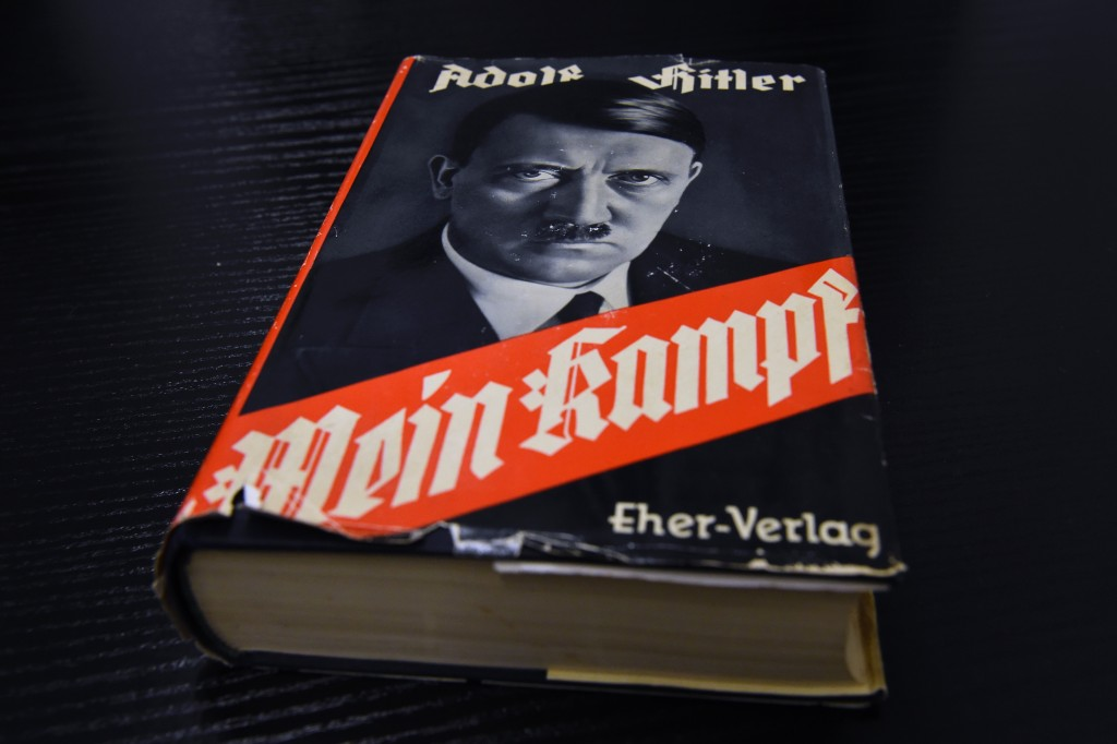 "A German edition of Adolf Hitler's ""Mein Kampf"" (My Struggle) is pictured at the Berlin Central and Regional Library (Zentrale Landesbibliothek, ZLB) in Berlin on December 7, 2015. For the first time since World War II, Adolf Hitler's ""Mein Kampf"" will be printed in Germany in January 2016 as an annotated edition published by the Institute of Contemporary History (IFZ) in Munich.  AFP PHOTO / TOBIAS SCHWARZ / AFP / TOBIAS SCHWARZ        (Photo credit should read TOBIAS SCHWARZ/AFP/Getty Images)"