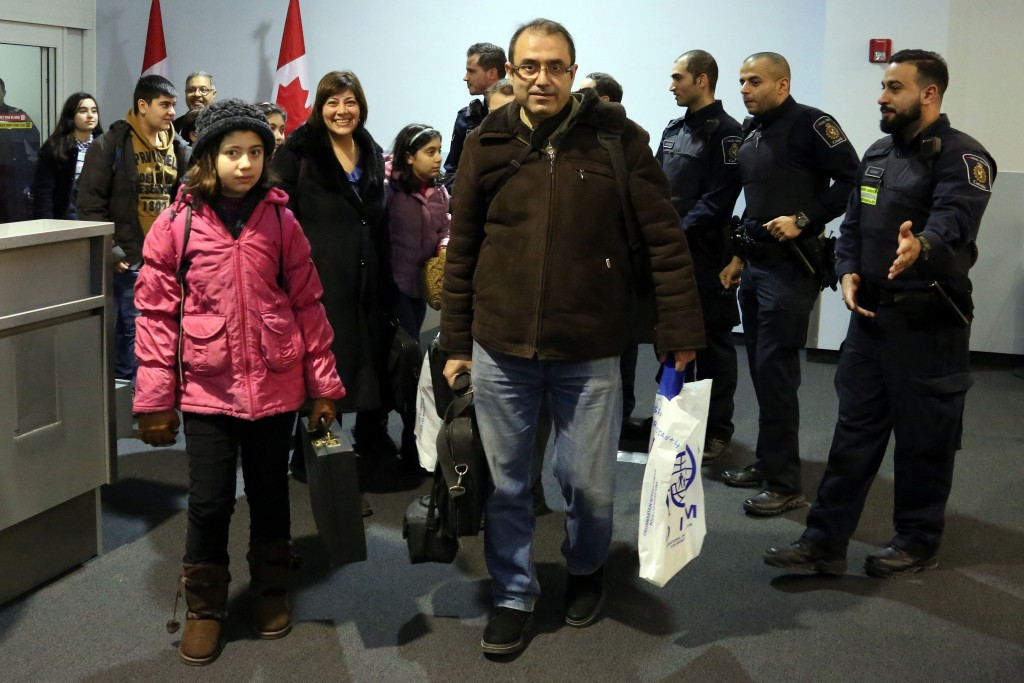TORONTO, CANADA - DECEMBER 11: The first Syrian refugee family to disembark at Toronto Pearson International Airport makes their way into the Canada Border Services Agencys processing area on December 11, 2015. (Photo by Kenneth Allan/Canada Border Services Agency/Pool/Anadolu Agency/Getty Images)