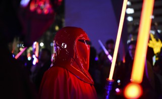 "A Star Wars fan dressed as an Imperial Guard attends Lightsaber Battle LA in Pershing Square in downtown Los Angeles, California on December 18, 2015. ""Star Wars: The Force Awakens"" smashed the opening night record in the United States and Canada positioning itself to become one of the biggest grossing movies ever, industry experts said.  AFP PHOTO / ROBYN BECK / AFP / ROBYN BECK        (Photo credit should read ROBYN BECK/AFP/Getty Images)"