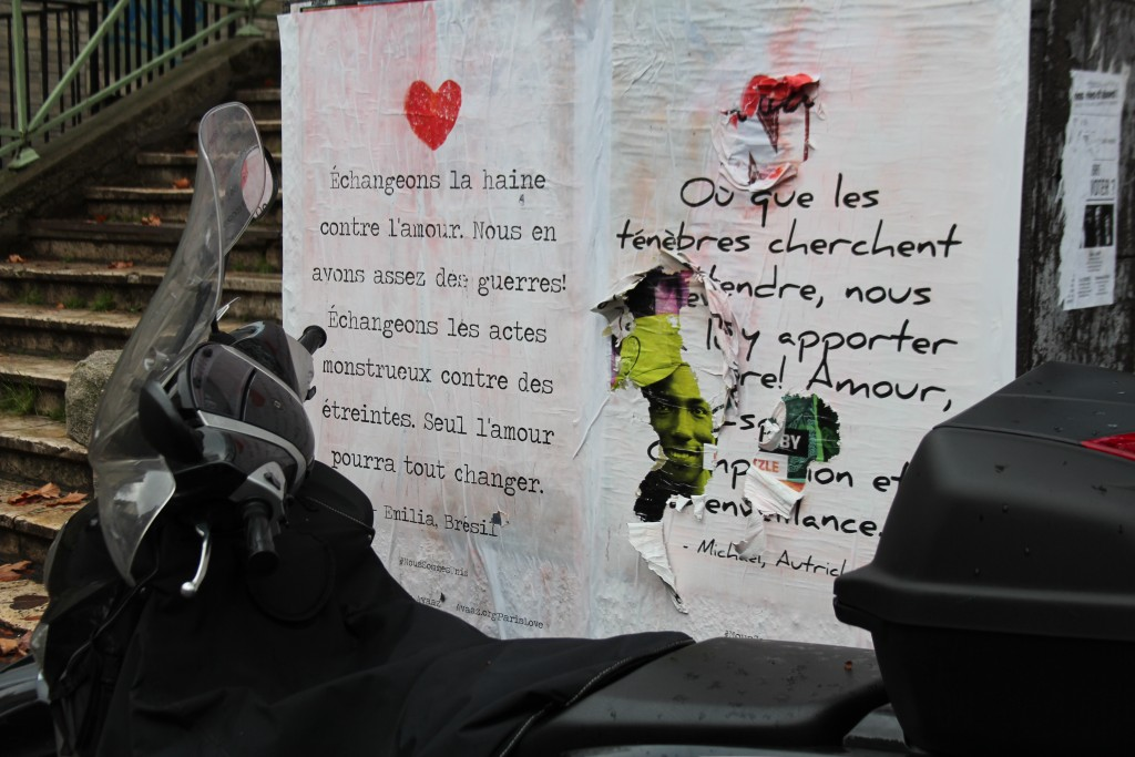 """A poster from Avaaz, a civic organization, reads """"""""Seul l'amour pourra tout changer"""" (""""Only love will change everything"""") on Nov. 25, 2015. Photo by Corinne Segal"""