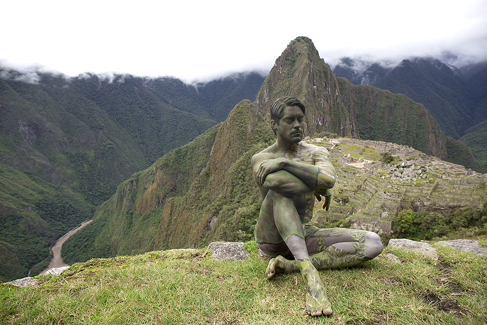 A model poses in front of Machu Picchu in Peru. Bodypaint and photo by Trina Merry