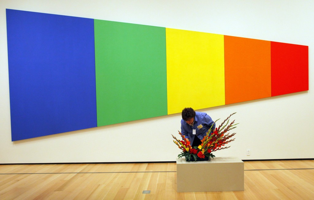 "Marisa McCoy, from the Wareham Garden Club, works on a floral arrangement related to Ellsworth Kelly's painting ""Blue Green Yellow Orange Red"" for Art In Bloom at the Museum of Fine Arts, in Boston, Massachusetts April 27, 2012. REUTERS/Brian Snyder (UNITED STATES - Tags: SOCIETY TPX IMAGES OF THE DAY) - RTR31B39"