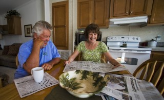 Mark Findlay and his wife Delores Findlay, of Erie, Pennsylvania, read the morning newspaper inside their home at Limetree Park where they spend the winter months in Bonita Springs, Florida, March 23, 2012. Medicare and Social Security, the massive programs that pay benefits to tens of millions of older Americans, are contentious issues in the 2012 presidential campaign. Seniors want the nation?s sputtering economy to be fixed, but not at their expense.   REUTERS/Steve Nesius  (UNITED STATES - Tags: ELECTIONS POLITICS SOCIETY) - RTR33B1K Related words: social security, medicare