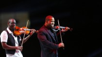 Black Violin perform at the Kids Inaugural concert for children and military families, one of the events ahead of the second-term inauguration of U.S. President Barack Obama in Washington January 19, 2013.  REUTERS/Eric Thayer (UNITED STATES  - Tags: POLITICS ENTERTAINMENT)   - RTR3CNYZ
