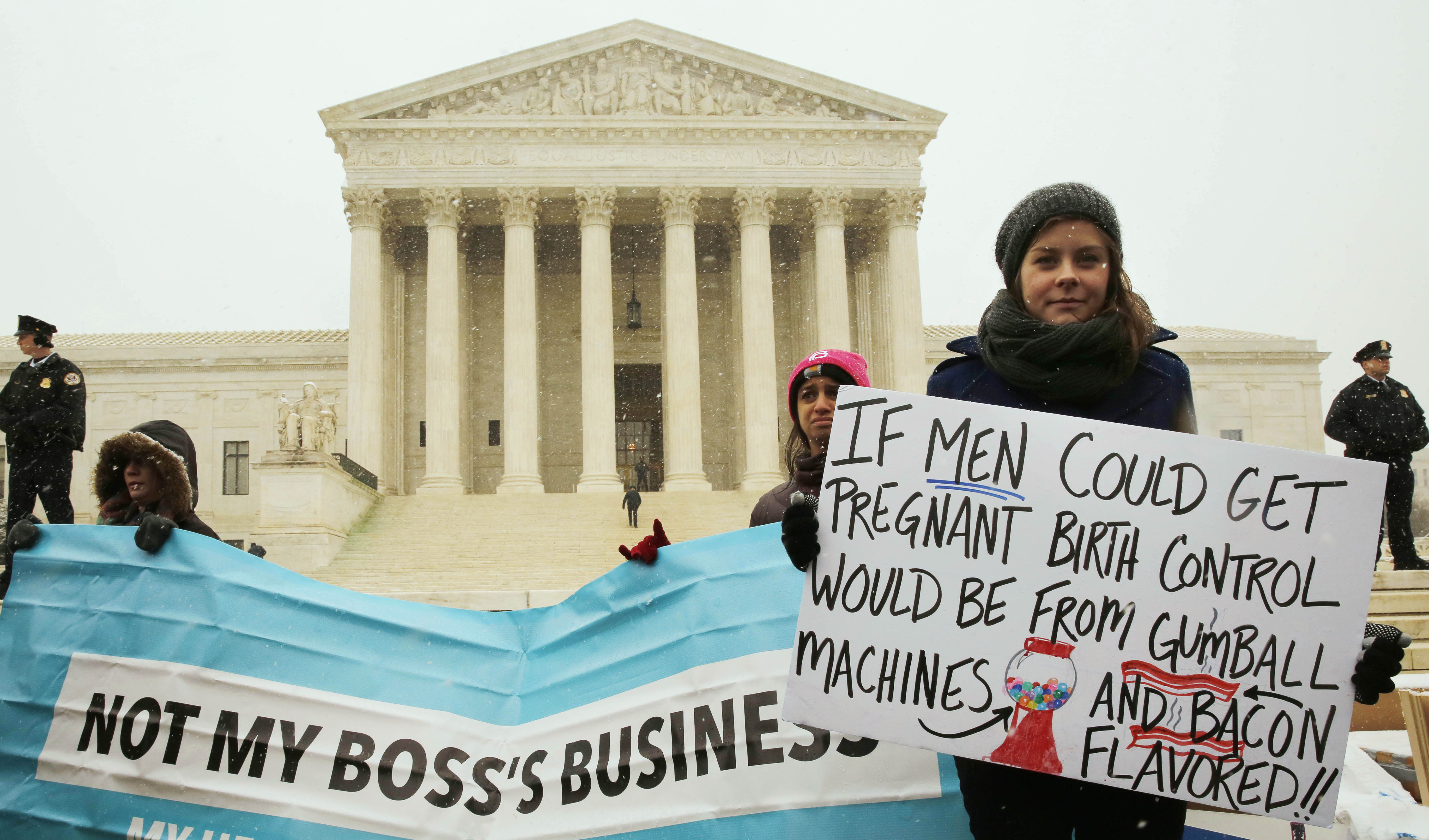A protester holds a sign at the steps of the Supreme Court last year as arguments began to challenge the Affordable Care Act's requirement that employers provide coverage for contraception as part of an employee's health care. Abortion rates have dropped by more than a third since the 1970s, according to recent CDC report.  Photos by Larry Downing/Reuters