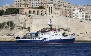 Phoenix I, the expedition vessel of the Migrant Offshore Aid Station (MOAS) project, sails out of Valletta's Grand Harbour for its first 20-day mission, August 25, 2014. The privately-funded humanitarian project initiated by Malta-based Christopher and Regina Catrambone, seeks to mitigate the loss of human lives by migrants attempting to cross the Mediterranean Sea into Europe. The Catrambones said they felt compelled to act following an appeal by Pope Francis after several hundred African migrants drowned off the Italian island of Lampedusa in October 2013. REUTERS/Darrin Zammit Lupi (MALTA - Tags: SOCIETY IMMIGRATION MARITIME) MALTA OUT. NO COMMERCIAL OR EDITORIAL SALES IN MALTA - RTR43PAN