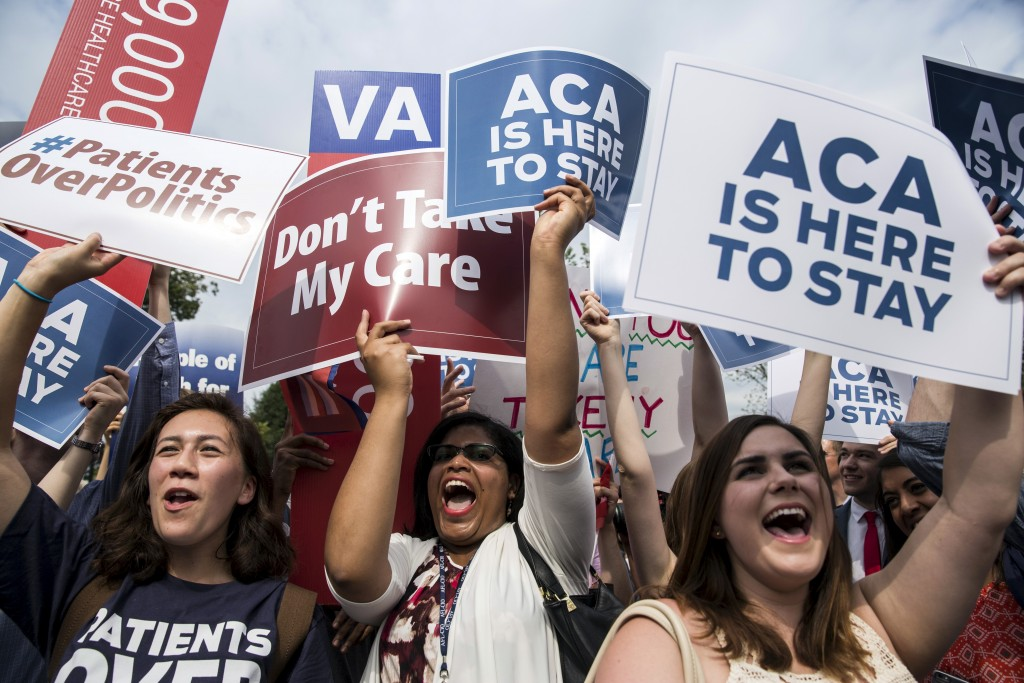 Supporters of the Affordable Care Act celebrate after the Supreme Court up held the law in the 6-3 vote at the Supreme Court in Washington June 25, 2015. More recently, Republicans have shifted tactics on the law, with attempts to use budgetary measures to install changes. Photo By Joshua Roberts/Reuters
