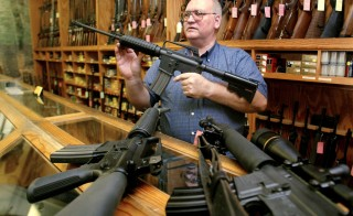 Gun dealer Tom Mannewitz displays several United States-made assault-style rifles inside his Dallas, Texas, gun shop in 2004. An unnamed source, who spoke on condition of anonymity, told the Associated Press that President Barack Obama is expected address background checks on gun sales next week. Photo by Jeff Mitchell/Reuters