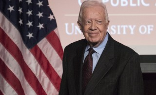 Former U.S. President Jimmy Carter arrives to speak during an event honoring former U.S. Vice President Walter Mondale hosted by the Humphrey School of Public Affairs at the University of Minnesota in Washington October 20, 2015. REUTERS/Joshua Roberts - RTS5DEJ