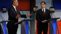Republican U.S. presidential candidate and former Governor Jeb Bush (L) speaks as U.S. Senator Marco Rubio (R) looks on during the debate held by Fox Business Network for the top 2016 U.S. Republican presidential candidates in Milwaukee, Wisconsin, November 10, 2015. REUTERS/Jim Young - RTS6E9H