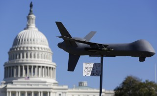 "Demonstrators deploy a model of a U.S. drone aircraft at the ""Stop Watching Us: A Rally Against Mass Surveillance"" near the U.S. Capitol in Washington, Oct. 26, 2013.   Photo By Jonathan Ernst/Reuters"
