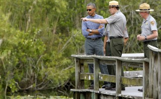U.S. President Barack Obama takes a walking tour of the Anhinga Trail at Everglades National Park, Florida, on April 22, 2015. The Obama administration and Republican lawmakers have vastly different ideas on how to improve trails, visitor centers, campgrounds and other features that need maintenance work in national parks across the country. Photo by Jonathan Ernst/Reuters