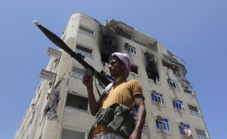 A Southern Popular Resistance fighter secures a street during fighting against Houthi fighters in the Dar Saad district of Yemen's southern port city of Aden May 9, 2015. REUTERS/Stringer - RTX1C93O