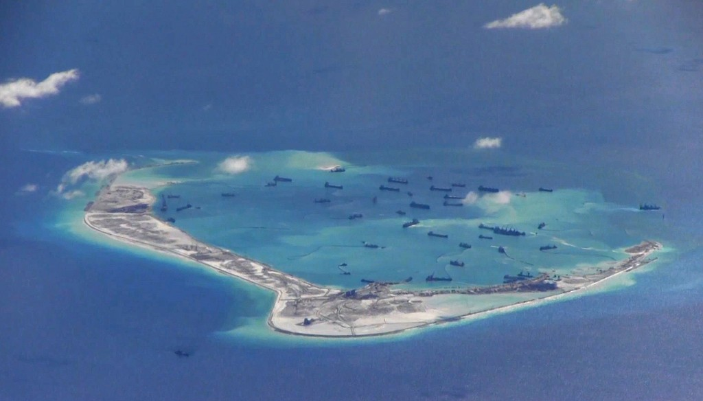 Chinese dredging vessels are purportedly seen in the waters around Mischief Reef in the disputed Spratly Islands in the South China Sea in this still image from video taken by a P-8A Poseidon surveillance aircraft provided by the United States Navy May 21, 2015. Photo by U.S. Navy via Reuters