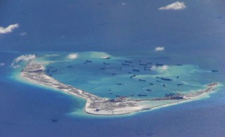 Chinese dredging vessels are purportedly seen in the waters around Mischief Reef in the disputed Spratly Islands in the South China Sea in this still image provided by the United States Navy May 21, 2015. As China grows more aggressive in asserting its claims to disputed territory, is the U.S. Navy too small to meet challenges posed by the Chinese navy Photo by U.S. Navy via Reuters