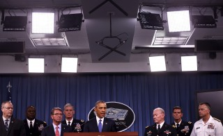President Barack Obama is flanked by military leaders as he delivers remarks after a briefing on U.S. efforts against the Islamic State at the Pentagon in Arlington, Virginia, July 6, 2015. Obama is planning a series of events this week aimed at allaying concerns about his strategy for fighting the militant group and its sympathizers. Photo by Jonathan Ernst/Reuters