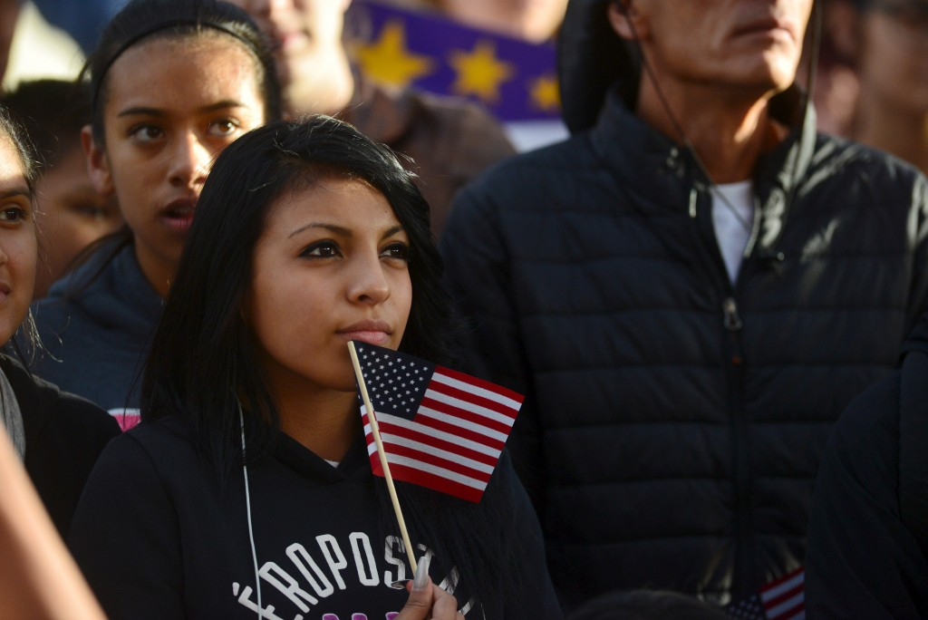 """Latino leaders and immigration reform supporters gather at Farrand Field on the campus of the University of Colorado to launch """"My Country, My Vote,"""" a 12-month voter registration campaign to mobilize Colorado's Latino, immigrant and allied voters October 28, 2015. The rally was held ahead of a forum held by CNBC before the U.S. Republican presidential candidates debate in Boulder. REUTERS/Evan Semon    - RTX1TQD8"""