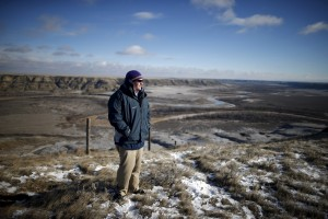 United States border patrol agent, Andrew Herdina looks towards the United States while standing next to the international border with Canada near Havre, Montana, United States, Nov. 20, 2015. Photo By Lucy Nicholson/Reuters