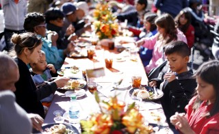 An early Thanksgiving meal is served to the homeless at the Los Angeles Mission in California. Experts say poverty is an issue that people on both sides of the political aisle agree needs to be addressed. Photo by Mario Anzuoni/Reuters.