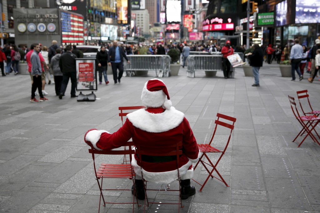 Santa Mark, a Santa Claus impersonator from Ansonia in Connecticut, sits in Times Square in the Manhattan borough of New York City on November 28. Photo by REUTERS and Andrew Kelly