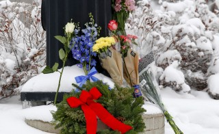 Flowers are left at an intersection nearby the scene of the Planned Parenthood shooting in Colorado Springs, Colorado, Nov. 28, 2015. The shooting has renewed debate over what is and isn't legally considered an act of domestic terrorism. Photo by Isaiah J. Downing/Reuters