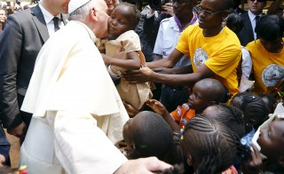 Pope Francis kisses a child at the refugee camp of Saint Sauveur in the capital Bangui, Central African Republic, on Nov. 29. Photo by Stefano Rellandini/Reuters