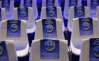 """General view of chairs with bags with the message, """"Act, Climate, Planet"""" at the World Climate Change Conference 2015 (COP21) at Le Bourget, near Paris, France on Dec. 1, 2015.  While President Barack Obama attended the 2015 climate talks in Paris, House Republicans voted Tuesday to disapprove of the president's plan to stem greenhouse gas emissions. Photo by Stephane Mahe/Reuters"""