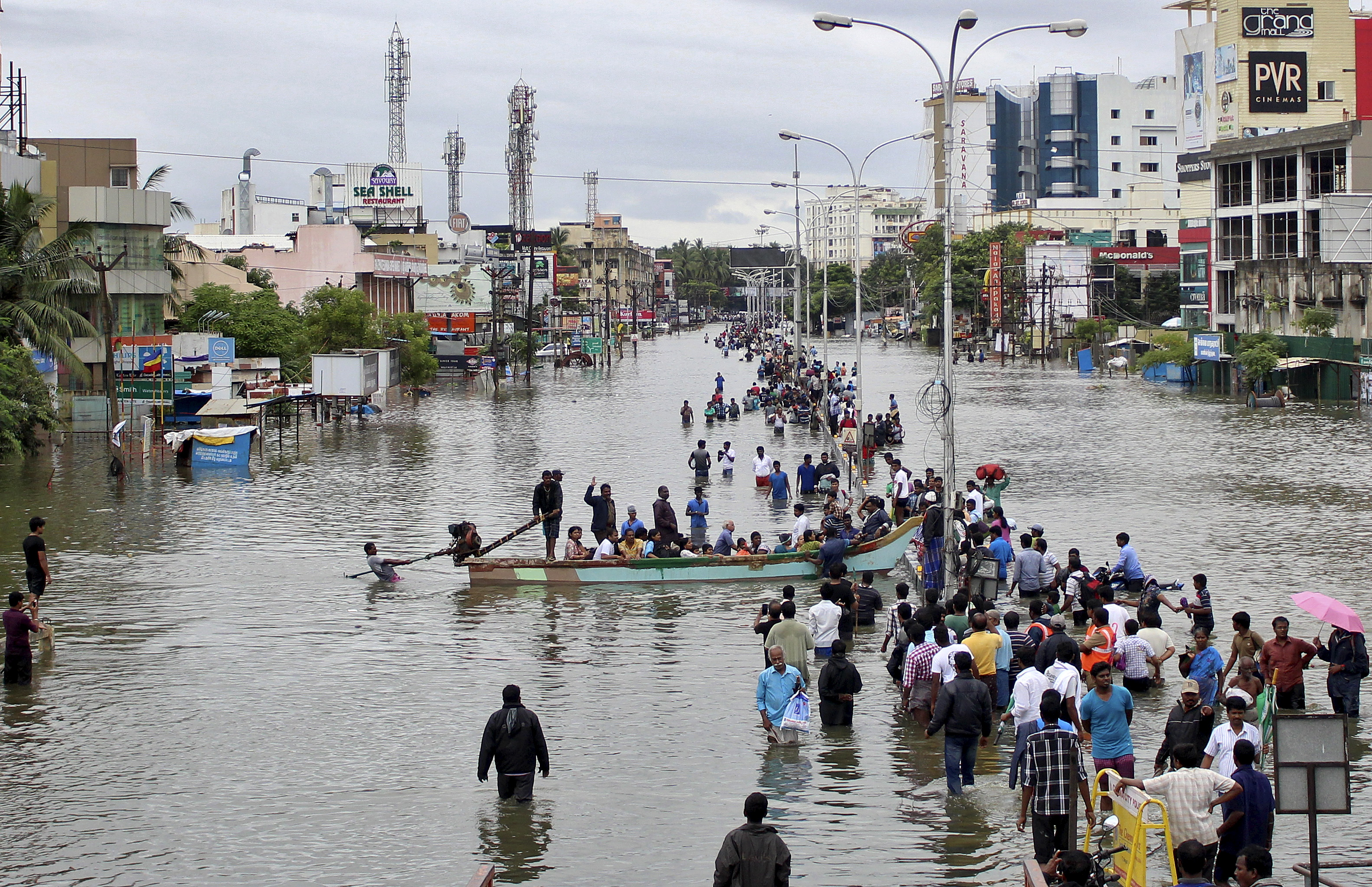 People travel by boat to safer places through a flooded road in Chennai, India, on Dec. 2. Photo by Reuters stringer