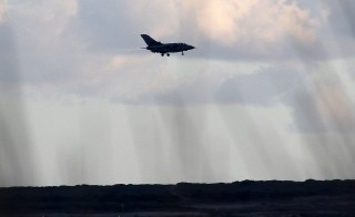 A British Tornado jet flies above RAF Akrotiri, a peninsula on the southern coast of Cyprus where Britain retains a military air base, Cyprus, December 2, 2015.The facility is likely to be the staging post for attacks on Syria if Britain's House of Commons approves the motion. REUTERS/Yiannis Kourtoglou - RTX1WU5E