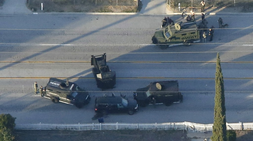 An SUV with its windows shot out that police suspect was the getaway vehicle from at the scene of a shooting in San Bernardino, California, is shown in this aerial photo. Gunmen opened fire at a social services agency Wednesday, killing 14 people and wounding 17 others, then fled the scene, triggering an intense manhunt and a shootoutout with police, authorities said. Photo by Mario Anzuoni/Reuters