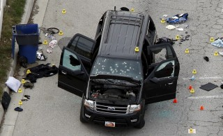 The remains of a SUV involved in the Wednesdays attack is shown in San Bernardino, California December 3, 2015. Authorities on Thursday were working to determine why a man and a woman opened fire at a holiday party of his co-workers in Southern California, killing 14 people and wounding 17 in an attack that appeared to have been planned. REUTERS/Mario Anzuoni  - RTX1X3GE