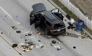 The remains of a SUV involved in the Wednesdays attack is shown in San Bernardino, California December 3, 2015. Authorities on Thursday were working to determine why a man and a woman opened fire at a holiday party of his co-workers in Southern California, killing 14 people and wounding 17 in an attack that appeared to have been planned. REUTERS/Mario Anzuoni  - RTX1X3M3