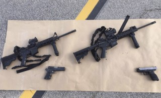 Weapons confiscated from last Wednesday's attack in San Bernardino, California are shown in this San Bernardino County Sheriff Department handout photo from their Twitter account released to Reuters December 3, 2015.  REUTERS/San Bernardino County Sheriffs Department/Handout  ATTENTION EDITORS - THIS IMAGE HAS BEEN SUPPLIED BY A THIRD PARTY. IT IS DISTRIBUTED, EXACTLY AS RECEIVED BY REUTERS, AS A SERVICE TO CLIENTS.  FOR EDITORIAL USE ONLY. NOT FOR SALE FOR MARKETING OR ADVERTISING CAMPAIGNS - RTX1X439