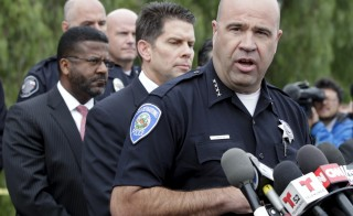 """San Bernardino Police Chief Jarrod Burguan (R) speaks during a news conference to discuss Wednesday's attacks with Federal Bureau of Investigation assistant director David Bowditch (2nd R) in San Bernardino, California December 4, 2015. The FBI is investigating this week's massacre in which a married couple killed 14 people in California as an """"act of terrorism,"""" an official said on Friday, saying the female shooter had pledged allegiance to a leader of the militant group Islamic State. REUTERS/Alex Gallardo - RTX1X8VO"""