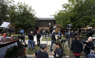 News media mingle outside the home of suspects Syed Rizwan Farook and Tashfeen Malik in Redlands, California, on Dec. 4, days after the couple died in a shootout with police. Farook and Malik opened fire on a holiday party, killing 14, on Dec. 2, 2015, and U.S. officials question how the couple's extremist views did not previously surface on law enforcement's radar. Photo by Mario Anzuoni/Reuters