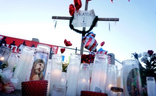"Momentos adorn a shrine following Wednesday's attack in San Bernardino, California December 5, 2015. Authorities are investigating the shooting as an ""act of terrorism"", Federal Bureau of Investigation assistant director David Bowdich said at a news conference on Friday. REUTERS/Sandy Huffaker - RTX1XBIQ"