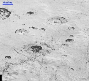 Pluto's icy cratered plains, including layering in the interior walls of many craters, are seen in this high-resolution image from NASA's New Horizons spacecraft released December 4, 2015.  Photo courtesy of NASA Handout via Reuters.