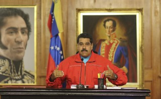 Venezuela's President Nicolas Maduro talks to the media during a news conference at Miraflores Palace in Caracas on Dec. 7. Photo by Miraflores Palace/Handout via Reuters