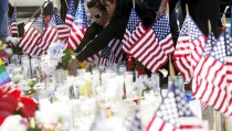"""People leave flowers at a makeshift memorial after last week's shooting in San Bernardino, California, on Dec. 7, 2015. Homeland Security said the department was reviewing its K-1 visa program, known as """"fiancé visas,"""" after one of the two shooters in the San Bernardino shooting moved to the United States to marry Syed Farook, her husband and accomplice in the massacre last week. Photo by Patrick T. Fallon /Reuters"""