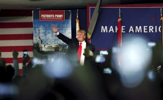 U.S. Republican presidential candidate Donald Trump waves to the crowd at a Pearl Harbor Day rally aboard in Mount Pleasant, South Carolina, on Dec. 7, 2015. Photo by Randall Hill/Reuters