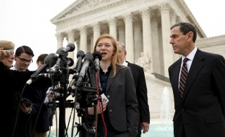 Abigail Fisher, the plaintiff in Fisher v. Texas, speaks outside the U.S. Supreme Court in Washington December 9, 2015. The U.S. Supreme Court on Wednesday appeared closely divided over the future of affirmative action in college admissions as the justices considered a challenge to the process for picking students used by the University of Texas at Austin. The court is weighing for the second time a challenge to the system used by the University of Texas at Austin brought by Fisher, who was denied entry to the entering class of 2008. REUTERS/Kevin Lamarque  - RTX1XYBY