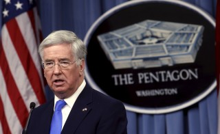 British Secretary of State for Defence Michael Fallon speaks during a joint news conference with U.S. Defense Secretary Ash Carter after their meeting at the Pentagon in Washington December 11, 2015. The defense chiefs discussed increased cooperation in the fight against Islamic State militants.  REUTERS/Kevin Lamarque - RTX1YB82