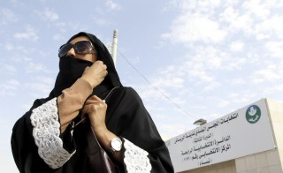 A Saudi woman leaves a polling station after casting her vote during municipal elections, in Riyadh, Saudi Arabia December 12, 2015. Photo by Faisal Al Nasser/Reuters.