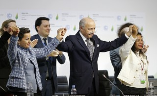 French Foreign Affairs Minister Laurent Fabius (C), President-designate of COP21 and Christiana Figueres (L), Executive Secretary of the UN Framework Convention on Climate Change, react during the final plenary session at the World Climate Change Conference 2015 (COP21) at Le Bourget, near Paris, France, December 12, 2015.     REUTERS/Stephane Mahe   - RTX1YEIR