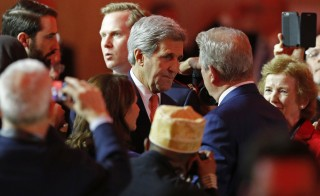 U.S. Secretary of State John Kerry (L) speaks with Al Gore, former U.S. Vice President and Climate Reality Project Chairman, at the World Climate Change Conference 2015 (COP21) at Le Bourget, near Paris, France, December 12, 2015. Climate negotiators in Paris appeared on the verge of clinching a landmark accord on Saturday to transform the world's fossil fuel-driven economy within decades and turn the tide on global warming.   Photo by Stephane Mahe/Reuters.
