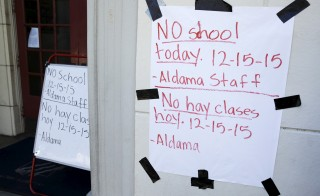 A sign announcing no school is pictured at Aldama Elementary School in the Highland Park neighborhood of Los Angeles, California December 15, 2015. All schools in Los Angeles, the second largest school district in the United States, were closed on Tuesday after officials reported receiving an unspecified threat to the district and ordered a search of all schools in the city. REUTERS/Jason Redmond - RTX1YUE7